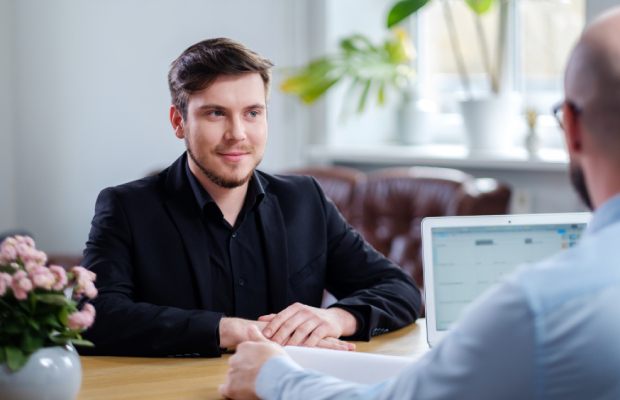 Young confident man in interview
