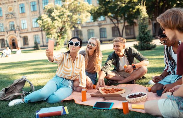 group of university students having a picnic on campus