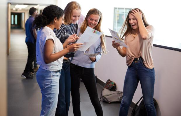 students excitedly reading their results