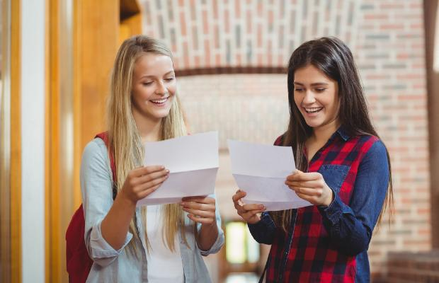 happy students reading their results