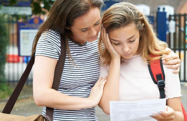 student looking worried about her exam results