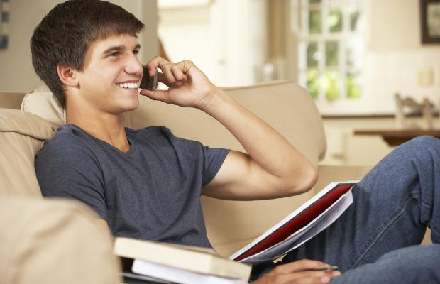 student talking on phone and smiling
