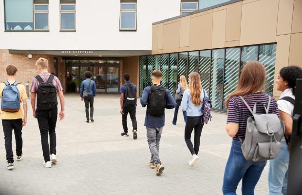 students walking into school