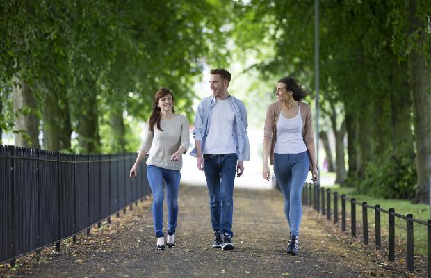 students walking through a park