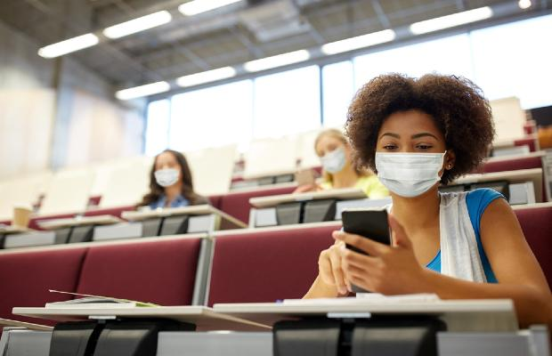 university students wearing face masks in a lecture hall