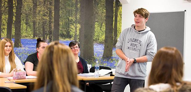 student giving presentation