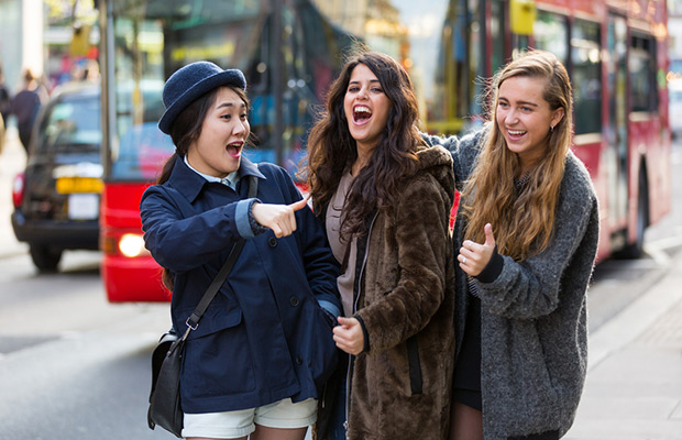 students laughing together on street