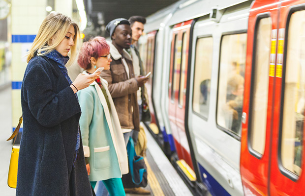 students waiting for tube train