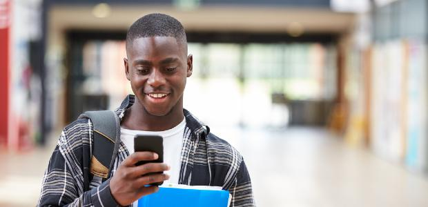 student looking at his phone
