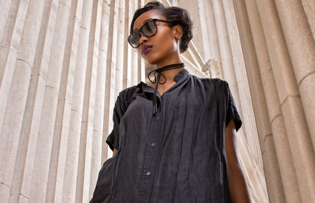Cool young woman wearing a dress and sunglasses