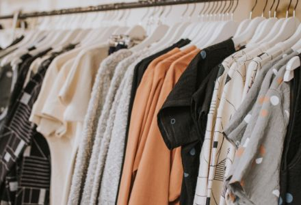 A rack of clothes in a shop