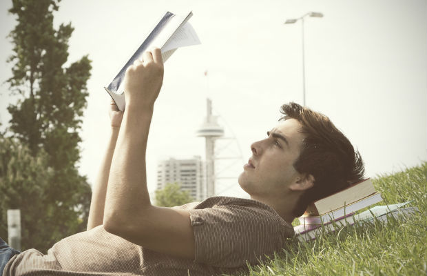 Student reading outside