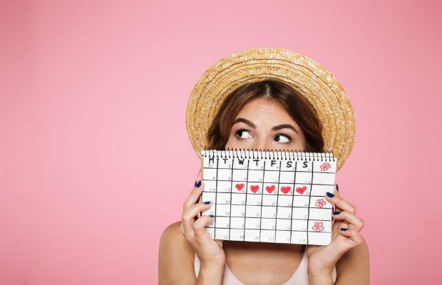 woman hiding behind calendar