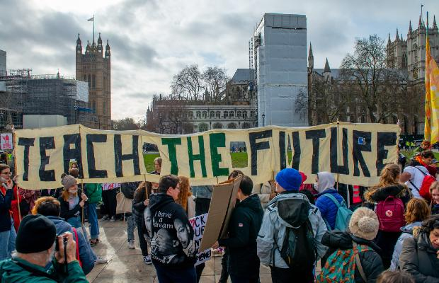 teach the future campaigners holding banner