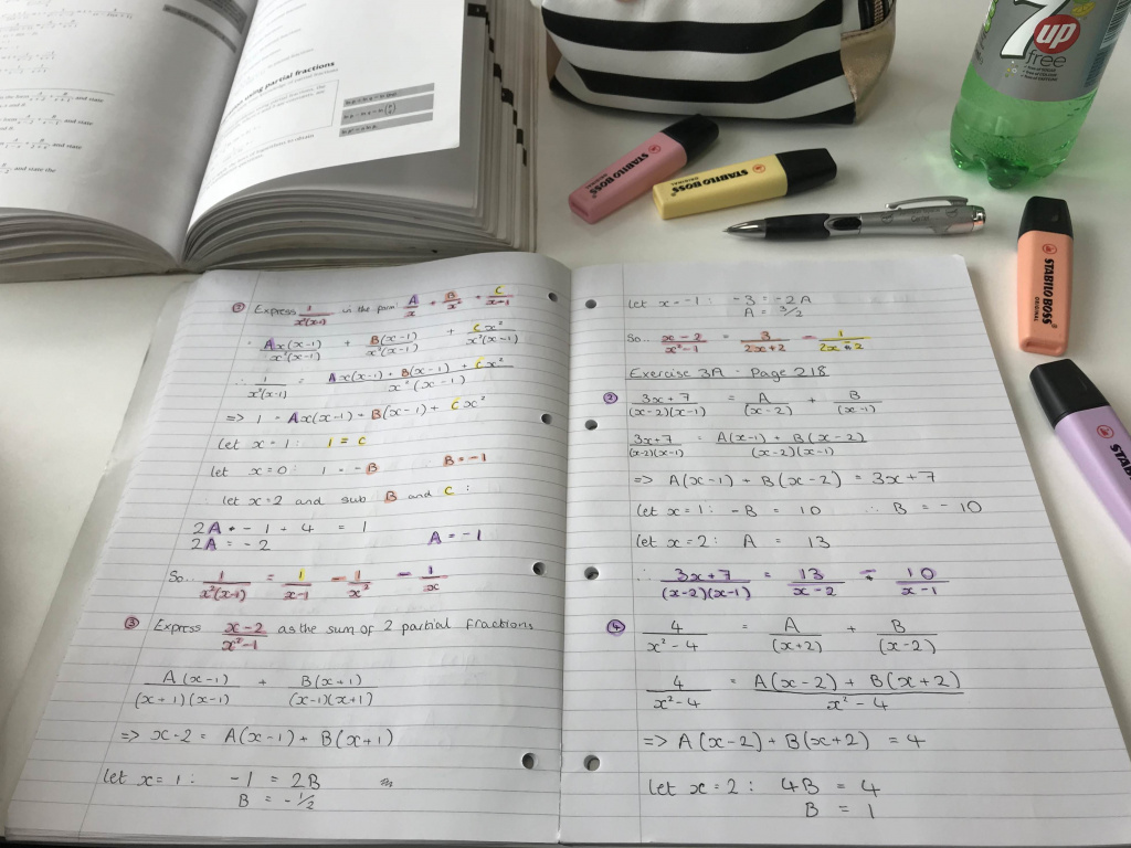 Textbook, notes and highlighter pens