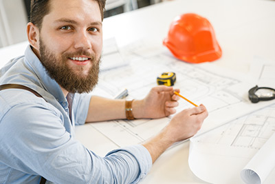 bearded architect smiling to camera