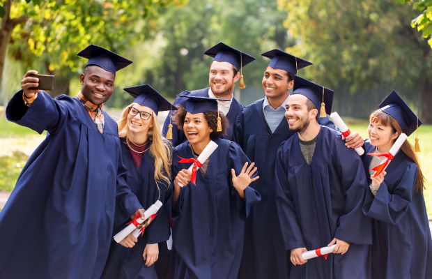 Graduates posing together for photo