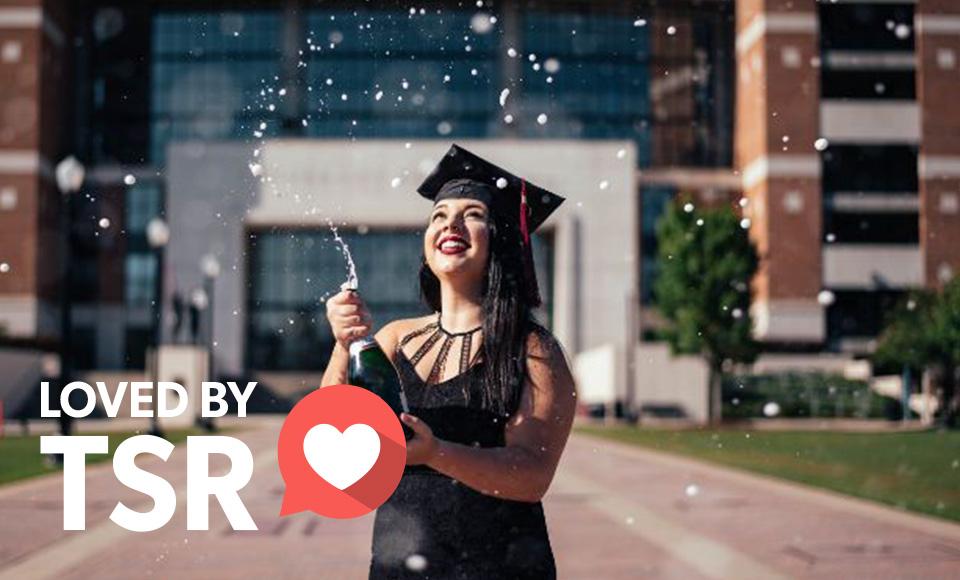 A female student celebrating her graduation