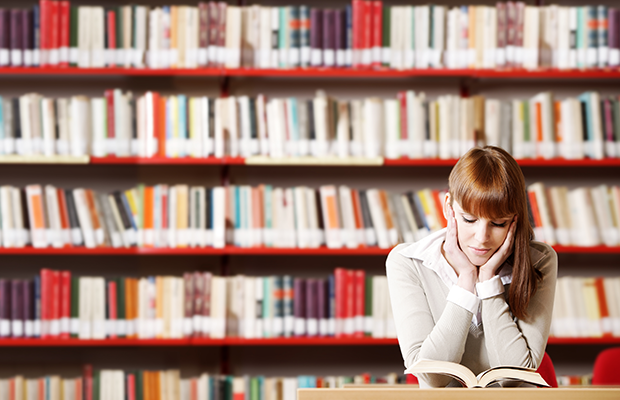 woman reading in the library