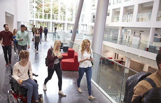 Students walking through university building