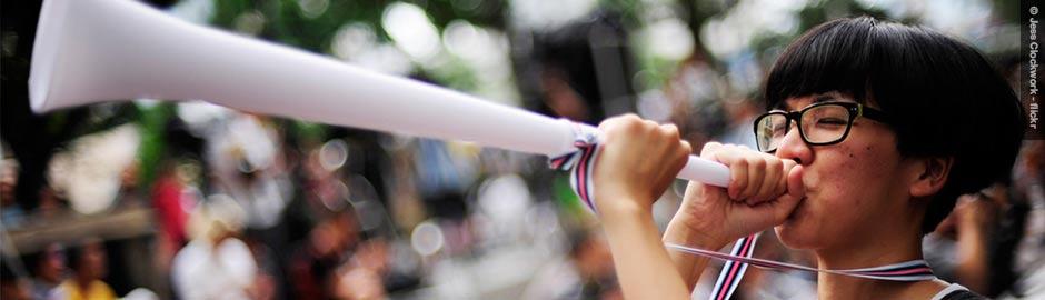 Child blowing trumpet