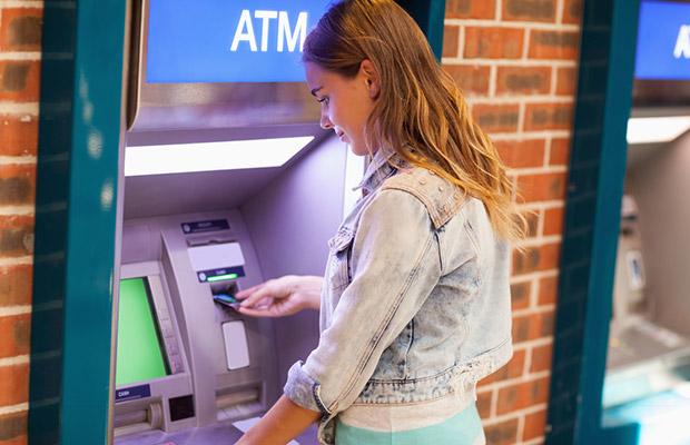 Student at cash machine
