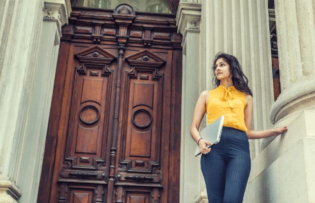 student on steps of law court