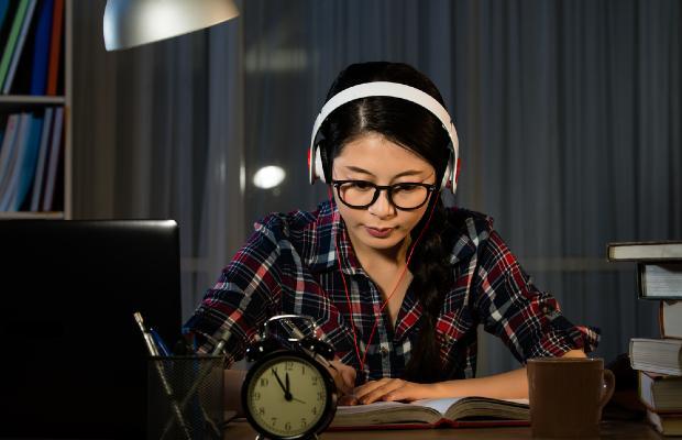 teenager studying in bedroom
