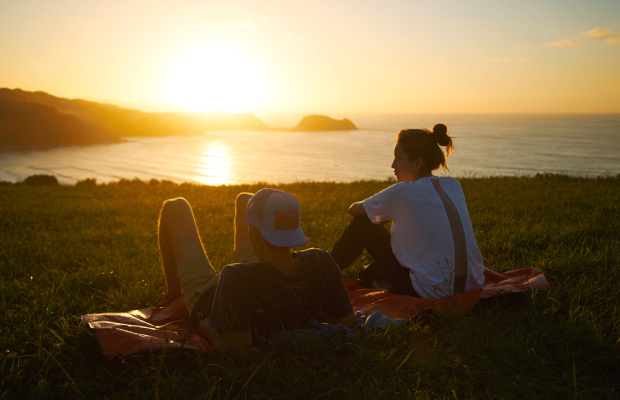 couple watching sunset together