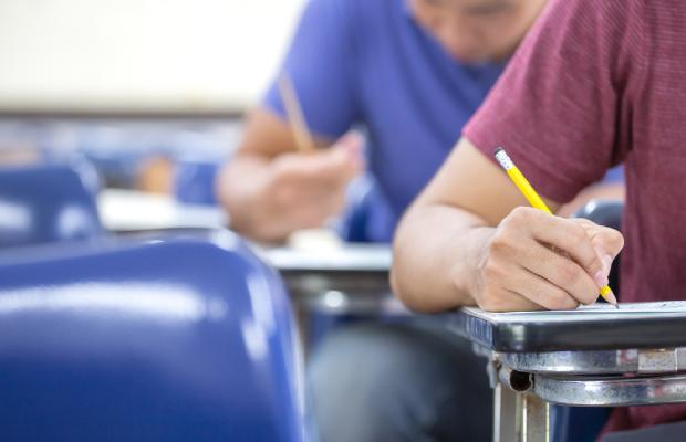 students writing an exam