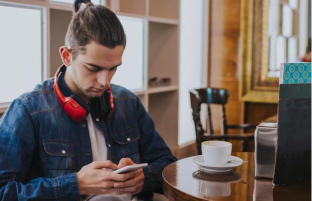 young man looking at phone