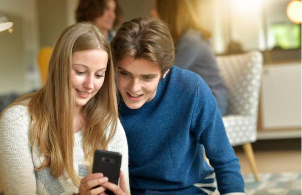 young couple looking at phone
