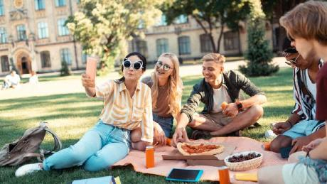 students having picnic on campus
