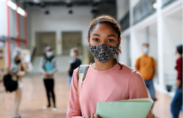 student in college with face mask