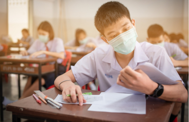 student working on school test