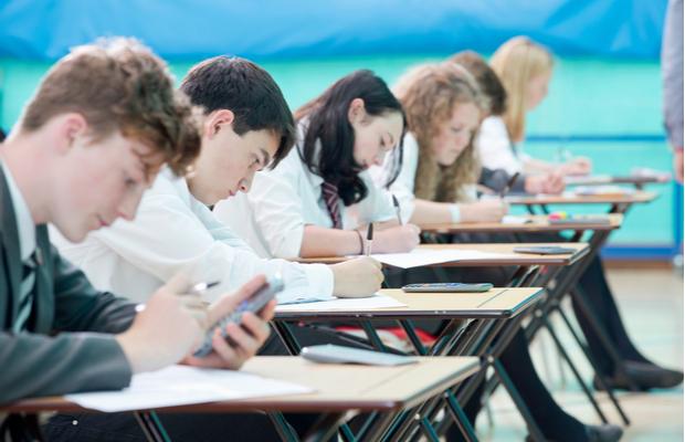 School students in an exam