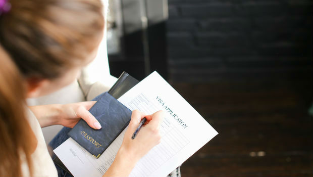Woman filling in visa form