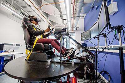 Student using one of the flight simulators