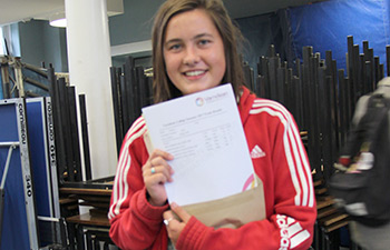 Student holding her exam results