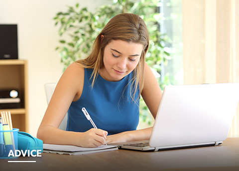 Young woman writing personal statement